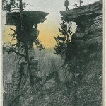 Man on top of Stand Rock, Kilbourn, Wis.